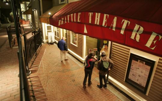 Patrons gathered outside the Brattle Theatre on Wednesday evening. On shaky financial grounds after a restoration just before 9/11, the theater again thrives. (John Bohn/Globe Staff)