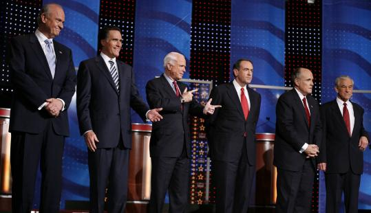 Republican presidential candidates onstage prior to the debate in Myrtle Beach, S.C., yesterday. Left to right are: Fred Thompson, Mitt Romney, John McCain, Mike Huckabee, Rudy Giuliani, and Ron Paul.