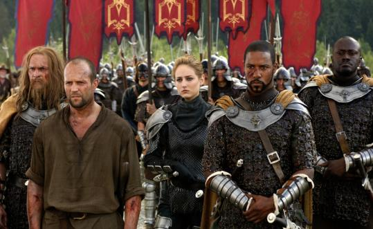 Jason Statham (second from left), Leelee Sobieski (center), and Brian White (second from right) star in 'In the Name of the King,' which is adapted from the video game Dungeon Siege.