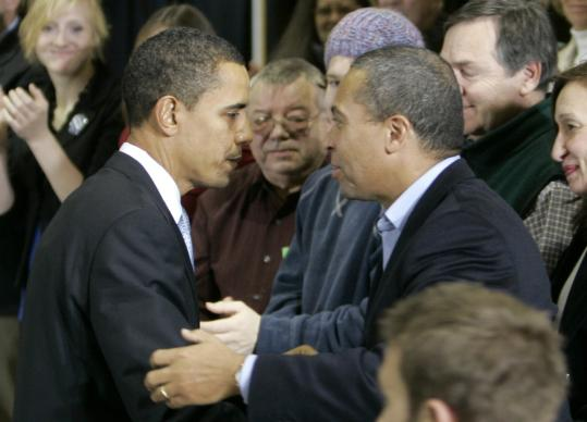 Senator Barack Obama of Illinois (left) and Governor Deval Patrick of Massachusetts gripped arms at a campaign rally in Mount Pleasant, Iowa, late last month. Patrick is emerging as one of Obama's most visible campaigning surrogates.