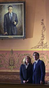 Mitt and Ann Romney stood inside Michigan's capitol rotunda under a portrait of his late father, George Romney, who has emerged in a central role in his son's campaign for president.