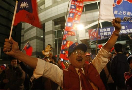 Supporters of the Nationalist Party celebrated outside party headquarters in Taipei after legislative elections yesterday.