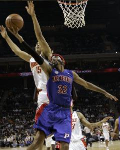 Detroit's Richard Hamilton (26 points) drives past Charlotte's pesky Ryan Hollins.