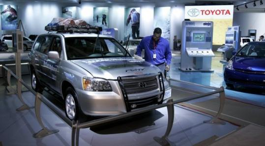 A Toyota hybrid vehicle on display at the North American International Auto Show in Detroit last week. Toyota says it is developing plug-in hybrids that run on lithium-ion batteries.