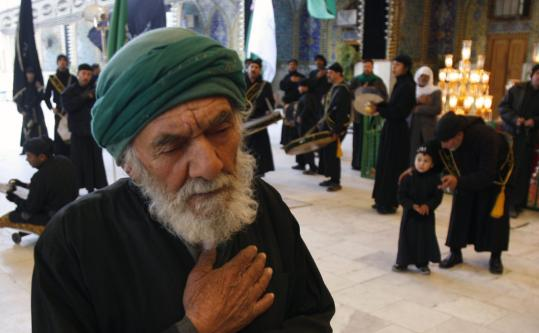 A worshiper visited the Imam Abaas shrine in Karbala, 50 miles south of Baghdad, yesterday. Iraqi Shi'ites are celebrating the Festival of Muharram, which marks the martyrdom of Imam Hussein, grandson of the Prophet Mohammed.