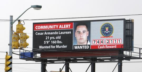 An electronic billboard in Columbus, Ohio, seeking the public's help and offering a reward for finding Corporal Cesar Laurean, a Marine wanted in the slaying of a pregnant fellow Marine, Lance Corporal Maria Lauterbach.