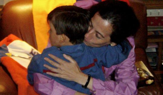 Clara Rojas was reunited with her son Emmanuel Sunday in Bogota. Rojas gave birth to Emmanuel when she