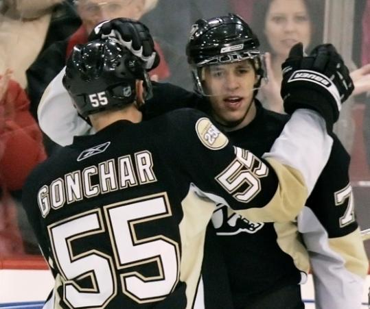 Evgeni Malkin celebrates with Sergei Gonchar after one of Malkin's two first-period goals.