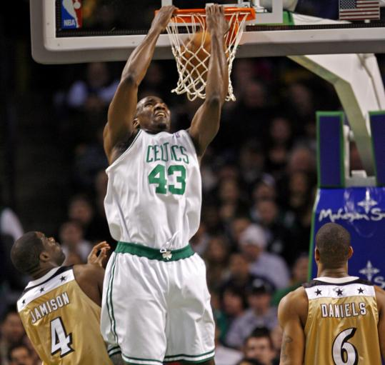 Kendrick Perkins is 'hands on' with a reverse dunk over Antawn Jamison and Antonio Daniels.