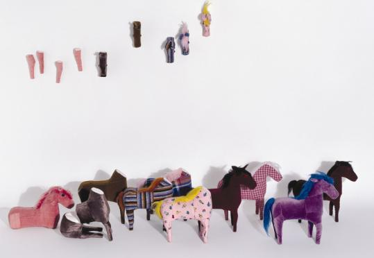 'Rebanho' (meaning flock or 'herd), 1992, by Lia Menna Barreto of Brazil, is a textile, fabric, glass, and synthetic fiber work.
