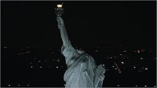 A decapitated Statue of Liberty stands in New York harbor in Paramount Pictures' 'Cloverfield.'