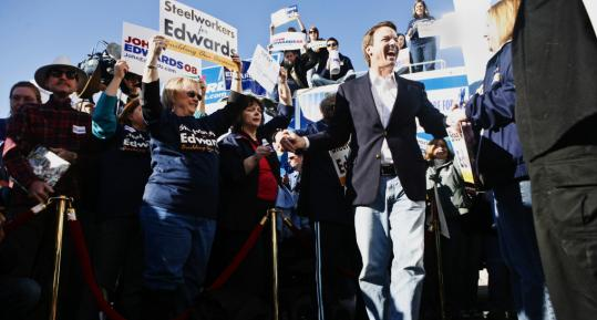 Democratic presidential candidate John Edwards greeted supporters yesterday at a rally outside his Las Vegas campaign headquarters. Nevada polls indicate he is in third place.