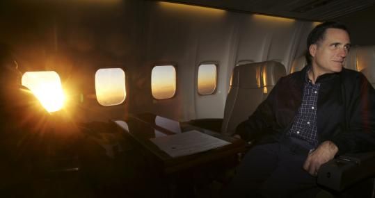 As the sun rose yesterday, Mitt Romney listened to a staff members as they flew over Nevada on his way to a campaign stop.