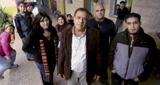 School principal Ali Zahalka (center) and supporters of the program, called 'national civilian service,' say it could benefit long-neglected communities by mobilizing a small army of helpers.