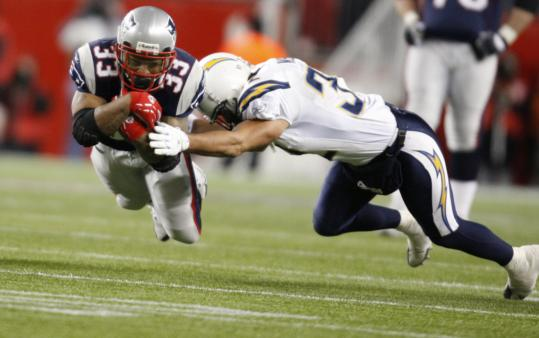 Chargers defenders - including safety Eric Weddle - had their hands full trying to slow down the Patriots' Kevin Faulk.