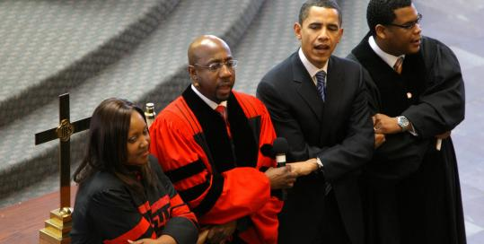 Barack Obama joined church officials in singing 'We Shall Overcome' at Ebenezer Baptist Church in Atlanta.