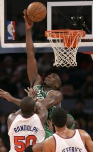 Playing above the rim, Celtics center Kendrick Perkins puts home 2 of his 24 points.