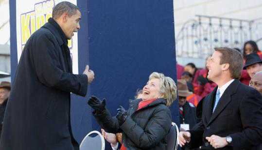 Senators Barack Obama of Illinois and Hillary Clinton of New York shared a light moment while former senator John Edwards of North Carolina looked on during an NAACP rally to mark Martin Luther King Day in Columbia, S.C.