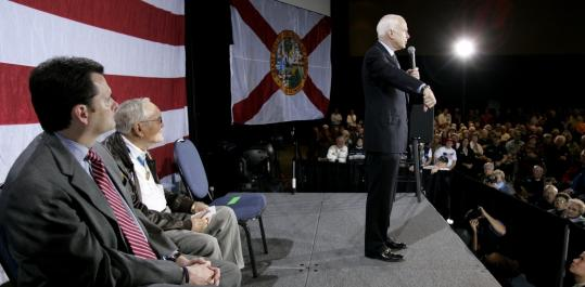 John McCain displayed the armband of a soldier killed in Iraq at a stop yesterday in Fort Walton Beach, Fla. The senator has led in some recent Florida polls.