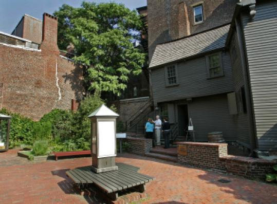 The grounds of the Paul Revere House are being examined by a radar device.