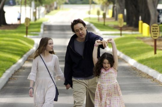 John Cusack plays a man who can't bring himself to tell his daughters (Shélan O'Keefe, left, and Gracie Bednarczyk) that their mother has been killed in Iraq.