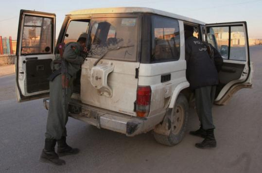 Afghan police officers searched a vehicle after an American aid worker was kidnapped in Kandahar yesterday. Cyd Mizell, 49, worked for the Asian Rural Life Development Foundation.