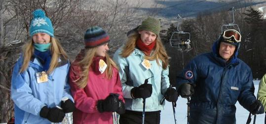 Dr. Nevin Scrimshaw (right) celebrated his 90th birthday skiing at Waterville Valley with granddaughters (from left) Kate, Emma, and Sayre.