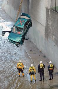 A car that plunged into the swollen Arroyo Seco river in Los Angeles was removed after its two occupants were rescued. Up to 2 inches of rain fell yesterday in Southern California's coastal areas. Some areas have received more moisture in a week than during last year's rainy season.