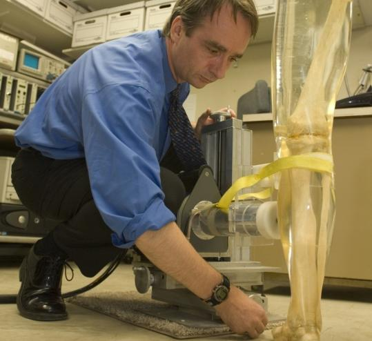Andrew Todd used an acrylic leg filled with human bone to calibrate the bone lead measurement system. A study suggests lead exposure can make a person's brain work as if it is older than it is.
