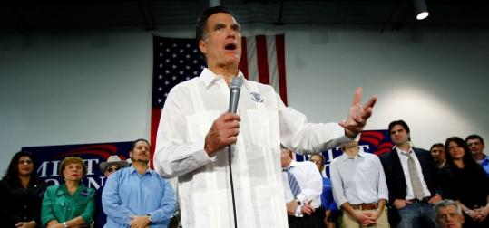 The guayabera, the traditional Cuban men's shirt, was an untraditional look for Mitt Romney as he spoke to mostly Cuban supporters yesterday at a campaign rally in Sweetwater, Fla.
