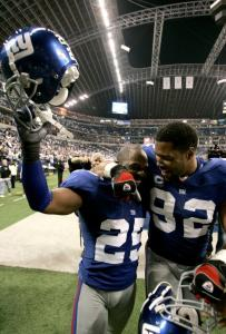 Given up for dead after two games, the Giants - such as R.W. McQuarters (left) and Michael Strahan - wound up with plenty to celebrate.