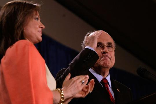 Rudy Giuliani saluted supporters last night as his wife, Judith, applauded during a postprimary campaign rally in Orlando, Fla. Giuliani hinted he might drop out of the race.