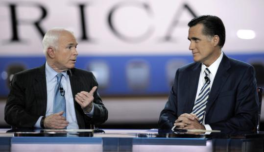 John McCain and Mitt Romney focused on each other during last night's GOP debate at the Ronald Reagan Presidential Library in Simi Valley, Calif.