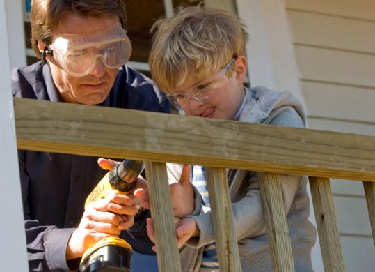 John Edwards and his son Jack did volunteer work in the Upper Ninth Ward of New Orleans. Edwards dropped out of the presidential race, but hasn't endorsed either of his rivals.