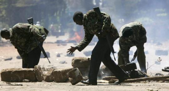 Police removed a road block yesterday north of Nairobi, Kenya. Protests over President Mwai Kibaki's disputed reelection in the Dec. 27 voting have degenerated into cycles of killing.