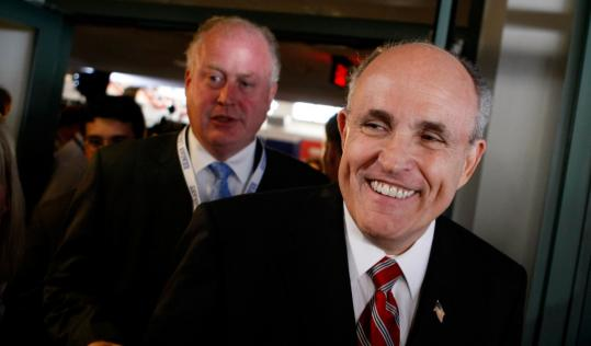 Rudy Giuliani betrayed no sadness after announcing his decision to quit the race for the GOP nomination yesterday in Simi Valley, Calif., and endorsing rival John McCain.