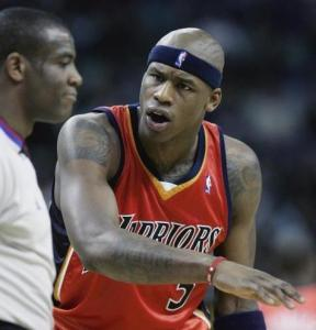 Golden State's Al Harrington takes out his aggression on referee Tony Brown.