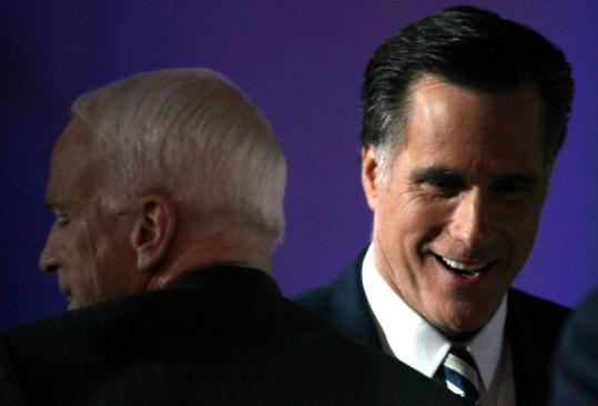 John McCain and Mitt Romney crossed paths Wednesday night after the two candidates battled back and forth at the Republican debate in California.