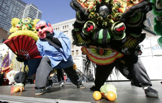 Lion dancers celebrate the Year of the Pig last February in the Chinatown section of Boston.