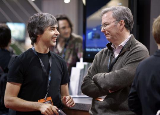 Google cofounder Larry Page (left) and CEO Eric Schmidt, at last month's Consumer Electronics Show. It's not yet clear if Google will stay in the bidding for airwave spectrum the government is auctioning.