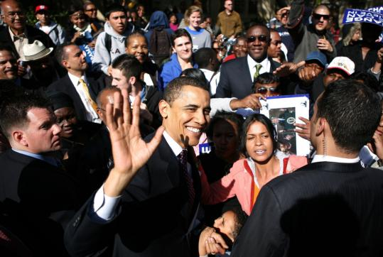 Barack Obama after a 'town hall' meeting in a heavily Hispanic neighborhood of south Los Angeles yesterday, where he recalled his days as a community organizer in multiethnic Chicago.