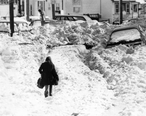 This woman sloshed through snow and water on Dolphin Avenue in the Beachmont section of Revere the Thursday after the Monday-Tuesday storm in 1978.