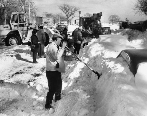 In South Boston one day after the storm ended, this unidentified man began to dig out his car from the side of Day Boulevard, near Farragut Road in the City Point section. National Guard crews and state workers manning front-end loaders also worked to remove cars and clear snow.
