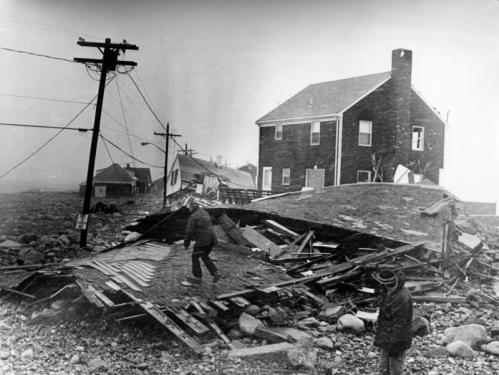 On Town Way at Peggotty Beach in Scituate, men clambered over the remains of a home that fell like a house of cards.