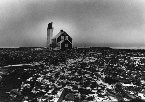 Near Scituate Light, which unlike most neighboring structures stood up to the pounding of the Blizzard of '78 churning high tides covered the road with stones and pieces of houses that had been destroyed.