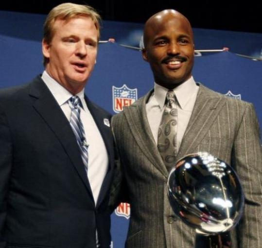 Mike Carey (right, with Roger Goodell) is the first black referee to work a Super Bowl.