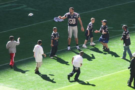 Football is child's play to Patriot Mike Vrabel. At least it was the day before the Super Bowl.