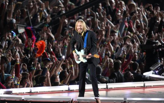 Venerable rocker Tom Petty and the Heartbreakers took center stage for a four-song performance in halftime festivities that stretched out 28 minutes.