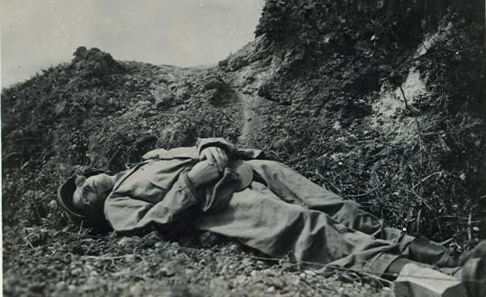 Ernie Pyle was killed when the jeep he was traveling in came under gunfire. Army photographer Alexander Roberts arrived at the scene shortly afterward and recorded the image.