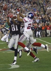 Randy Moss (five catches for 62 yards) can't haul in this late fourth-quarter pass, with the Giants' Corey Webster defending.
